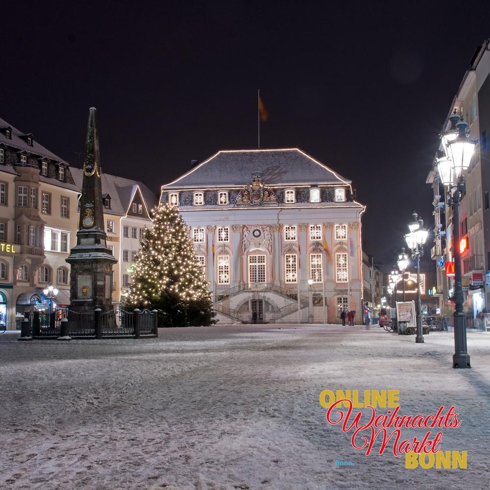 Der verschneite Bonner Münsterplatz mit Blick auf das alte Rathaus.
